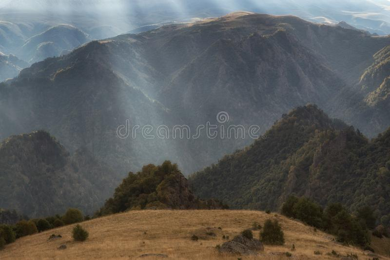 Bizarre mountainous landscape filmed against the light. stock photos