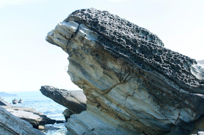 Bizarre rock on the seashore of volcanic stone royalty free stock photos