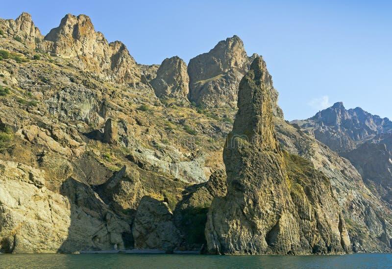 Bizarre rocks of the Kara-Dag.View from the sea. royalty free stock photo