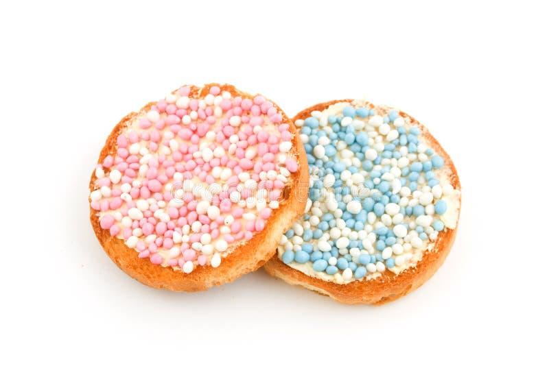 Bizcochos tostados con los ratones rosados y azules imágenes de archivo libres de regalías