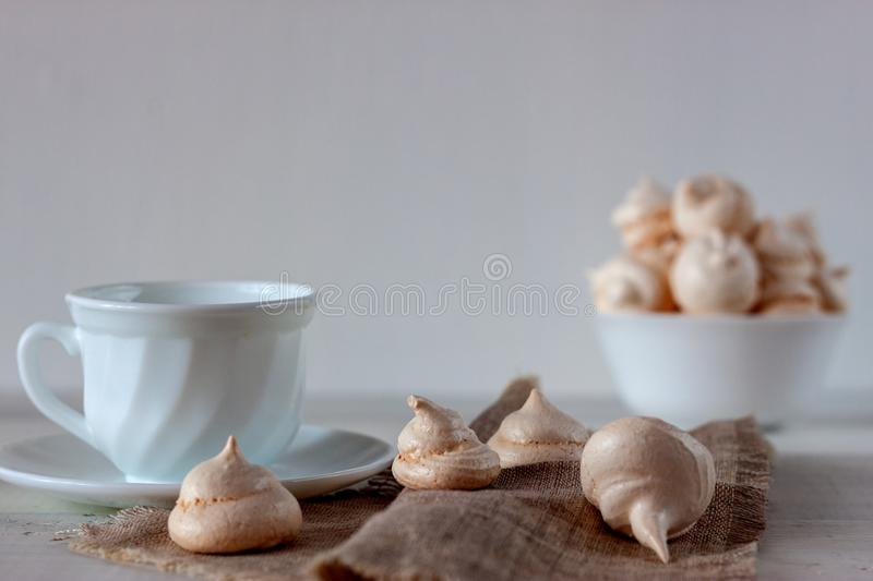 Bizet in the bowl. White buzed pattern. Bized texture. On the white wooden table is a cup with bizet royalty free stock photo