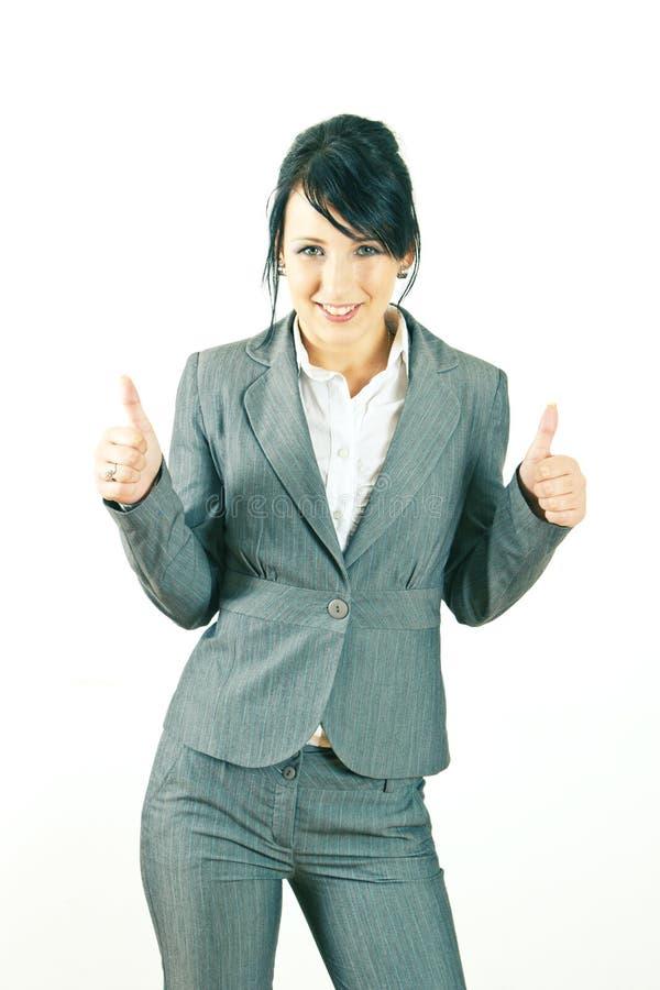 biznes daje uśmiechniętym aprobat kobiety potomstwom zdjęcia stock