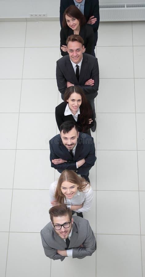 Biznes drużynowa pozycja w kolumnie na białym tle fotografia royalty free