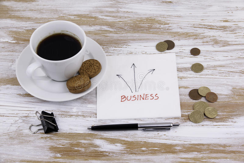 Biznes Handwriting na pielusze z filiżanką kawy fotografia royalty free