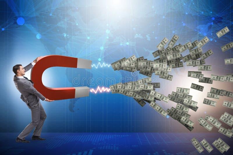 Biznesmenów chwytający dolary na podkowa magnesie obraz royalty free