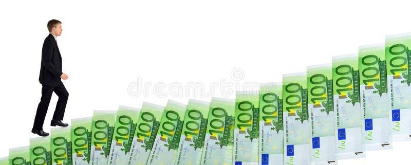 Biznesmenów wspinaczkowi up schodki pieniądze zdjęcia stock