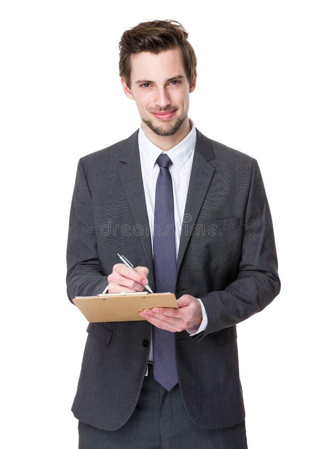 Biznesmen bierze notatkę na schowku zdjęcie royalty free