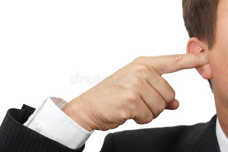 Biznesmen blokuje jego ucho z palcami głuchy kierownik conc zdjęcie stock