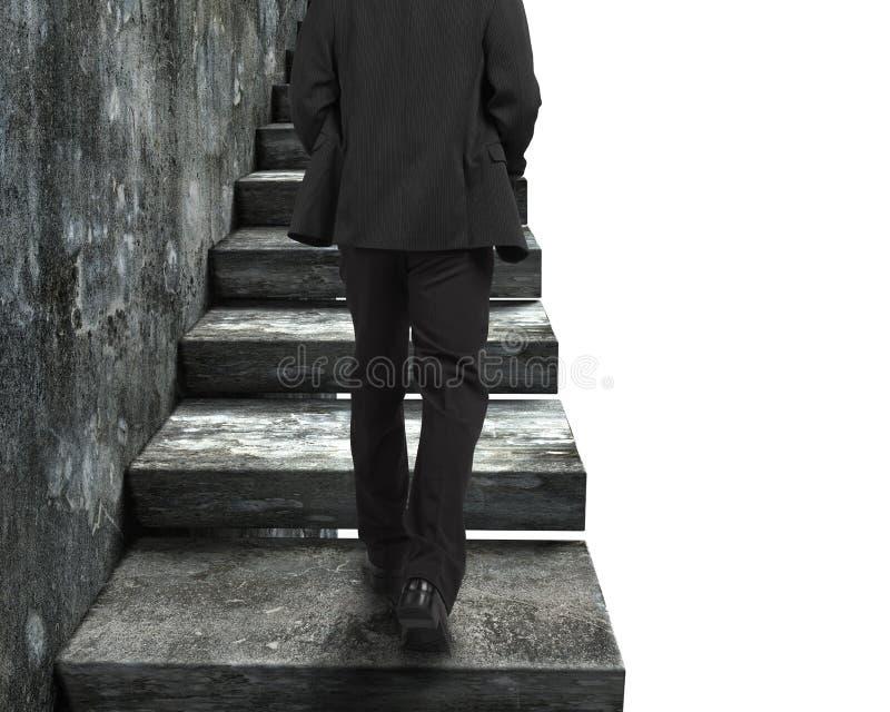 Biznesmen chodzi w górę starych betonowych schodków zdjęcia stock