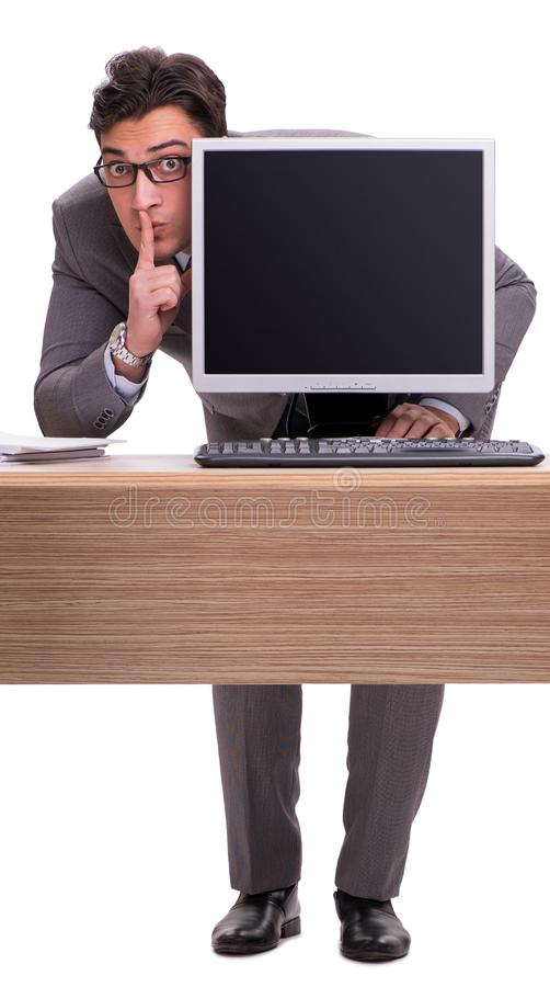 Biznesmen chuje w biurze odizolowywaj?cym na bielu zdjęcia stock