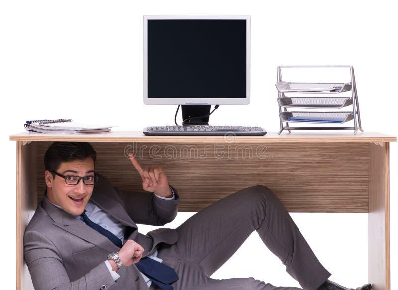 Biznesmen chuje w ofice zdjęcie stock