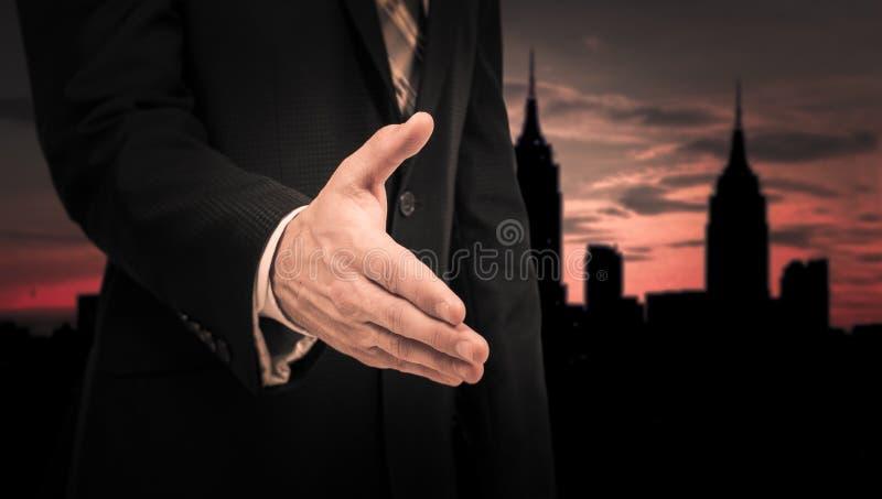 Biznesmen daje jego ręce dla uścisku dłoni partner zdjęcia royalty free