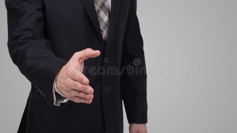 Biznesmen daje jego ręce dla uścisku dłoni partner obrazy royalty free