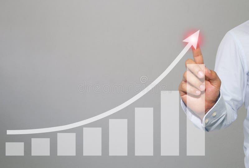 Biznesmen dotykać w szczycie Biznesowy wykres na szarość cementuje wa obrazy stock