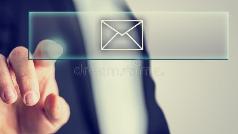 Biznesmen dotyka poczta ikonę zdjęcie royalty free