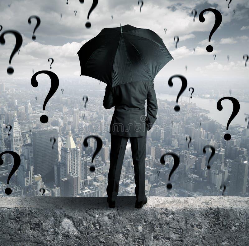 Biznesmen i pytania zdjęcie stock