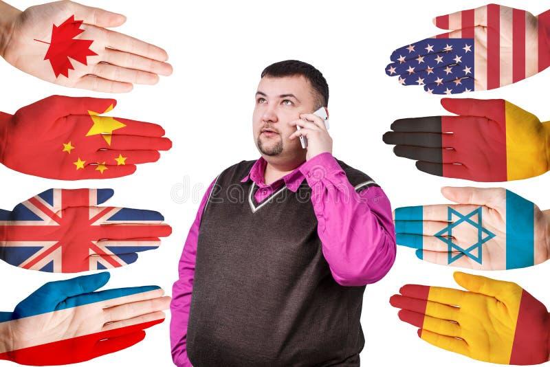 Biznesmen i wiele ręki z różnymi flaga zdjęcie stock