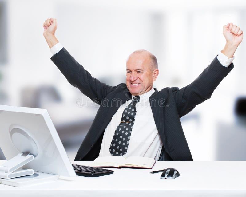 biznesmen jego biurowy działanie obraz stock