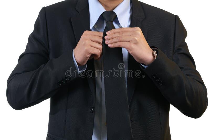 Biznesmen jest ubranym czarnego kostium Stojak ręki krawat Biały tło używać jako tła biznesowy pojęcie z kopii przestrzenią a fotografia stock