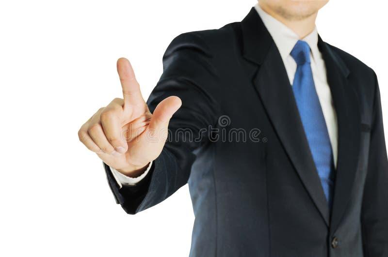 Biznesmen jest wskazujący, pchający lub dotykający naprzód nad białym tłem, obrazy royalty free
