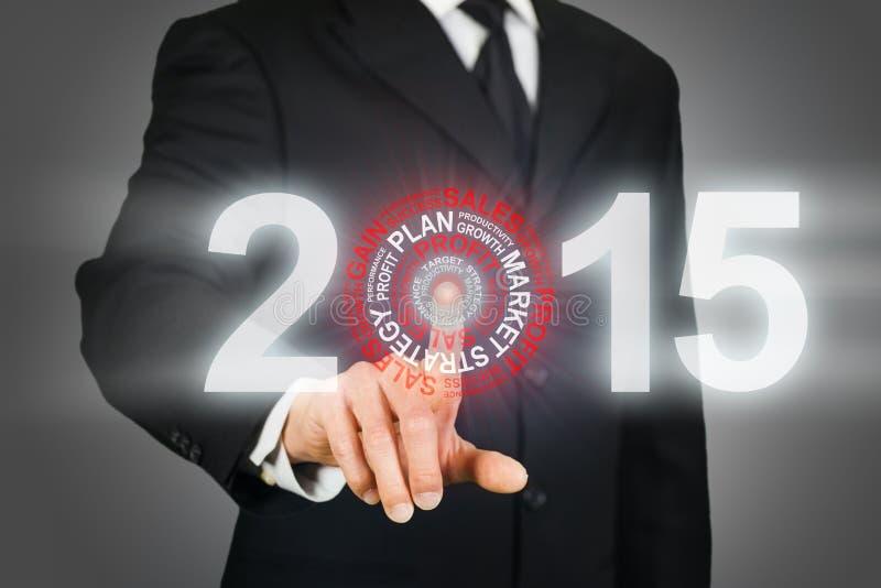 Biznesmen klika na 2015 biznesowych celach obrazy stock