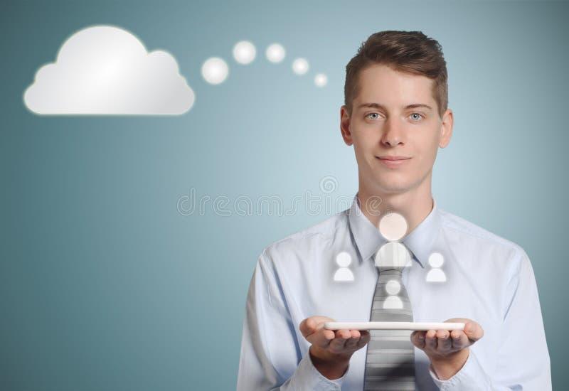 Biznesmen komputerowej pastylki ogólnospołeczne medialne ikony w chmurze obraz royalty free