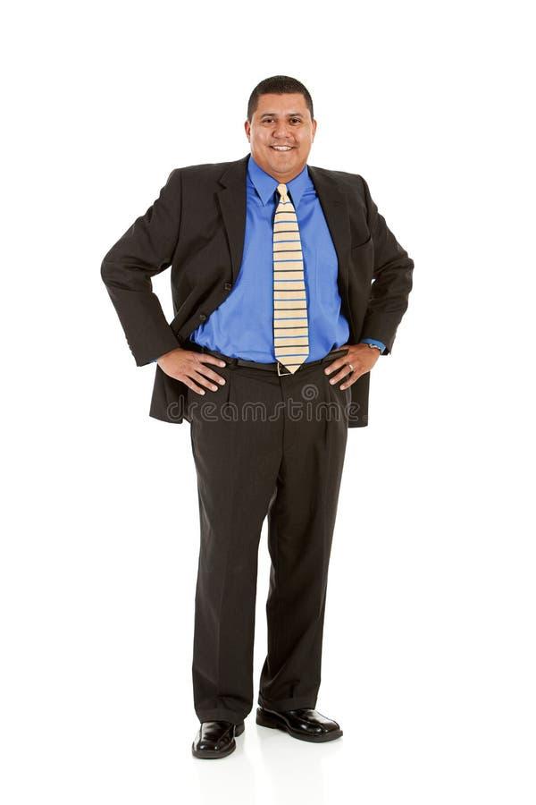 Biznesmen: Mężczyzna pozycja z rękami na biodrach obrazy stock