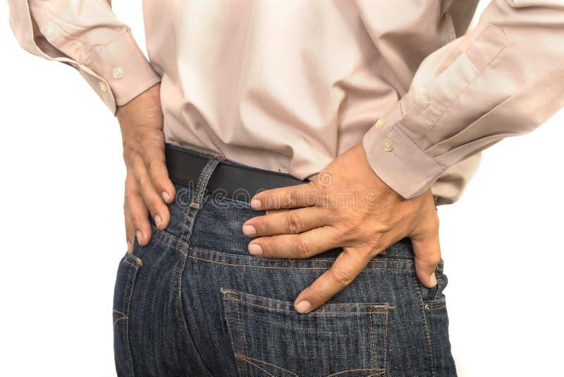 Biznesmen ma niskiego ból pleców, Biurowy syndromu pojęcie fotografia stock