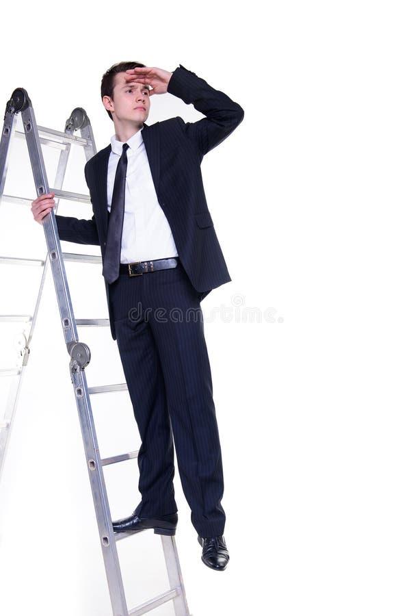 Biznesmen na drabinowym gmeraniu dla możliwości zdjęcie stock