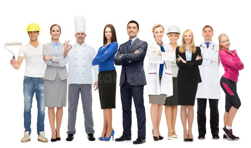 Biznesmen nad różnymi fachowymi pracownikami zdjęcia royalty free
