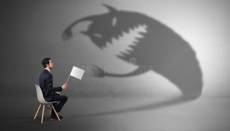 Biznesmen negocjuje z potwora cieniem fotografia royalty free
