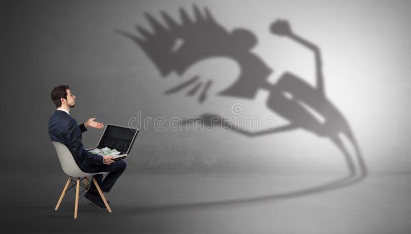 Biznesmen negocjuje z potwora cieniem obrazy stock