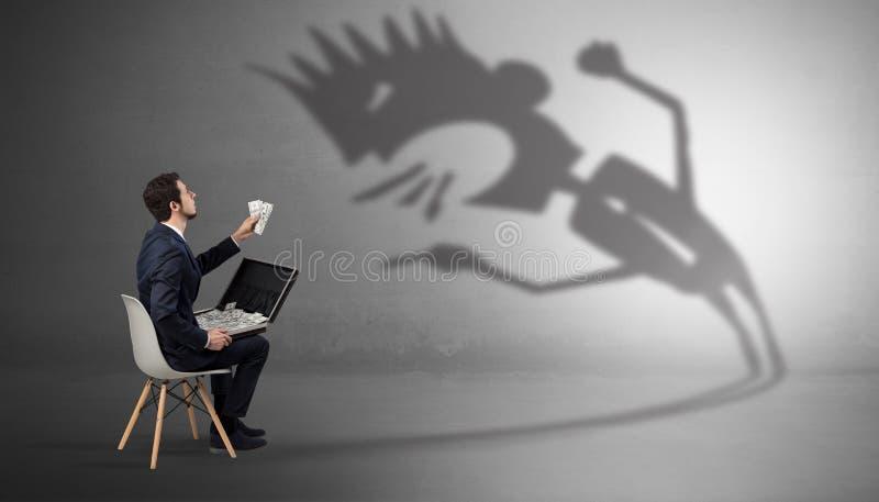 Biznesmen negocjuje z potwora cieniem obrazy royalty free