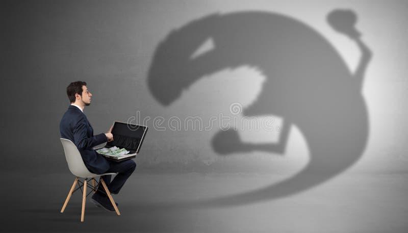 Biznesmen negocjuje z potwora cieniem zdjęcia stock