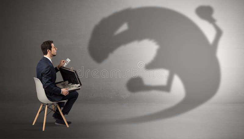 Biznesmen negocjuje z potwora cieniem zdjęcie stock