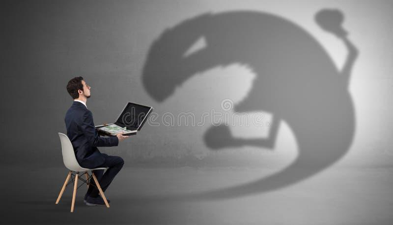 Biznesmen negocjuje z potwora cieniem zdjęcie royalty free