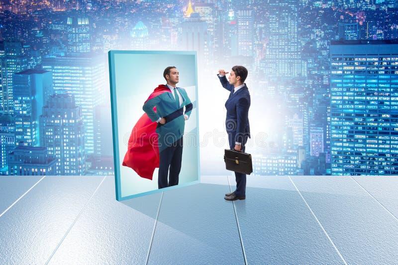 Biznesmen ono widzii w lustrze jako bohater obrazy royalty free