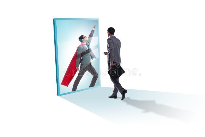Biznesmen ono widzii w lustrze jako bohater obrazy stock