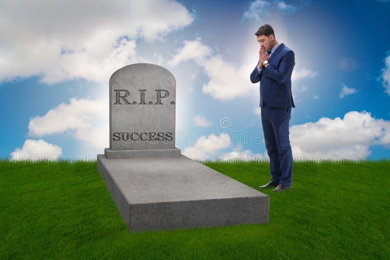 Biznesmen opłakuje śmierć sukces fotografia stock