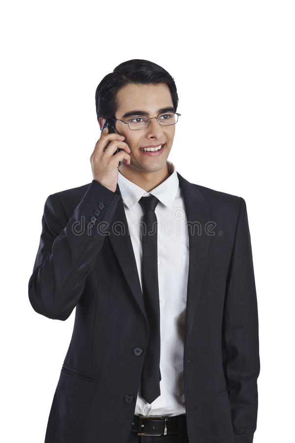 Biznesmen opowiada na telefonie komórkowym obraz stock