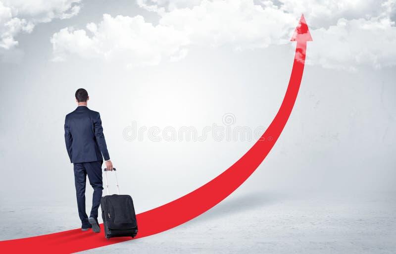 Biznesmen opuszcza na czerwony chodnik strzała fotografia stock