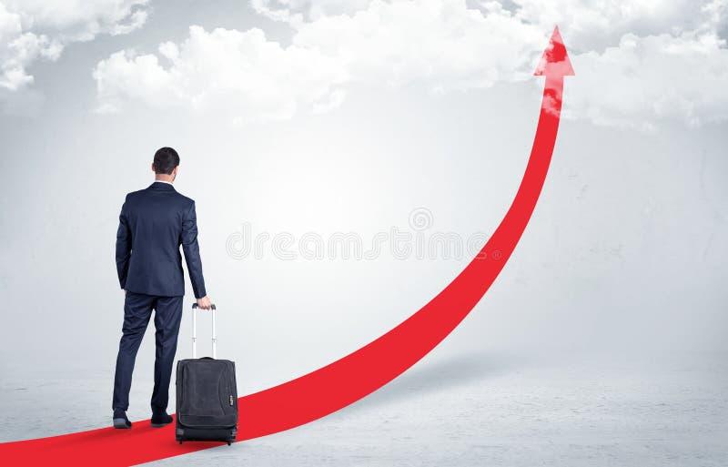 Biznesmen opuszcza na czerwony chodnik strzała obraz stock