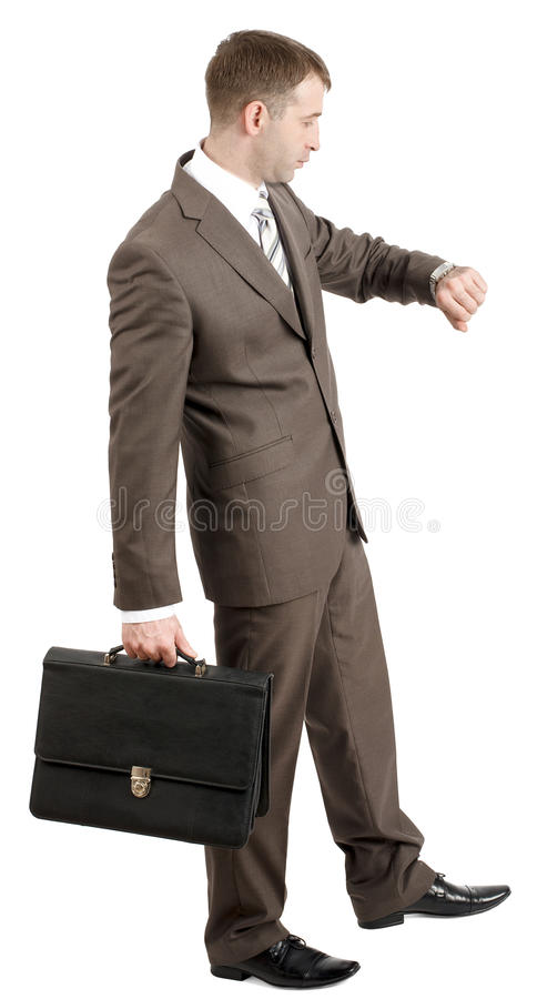 Download Biznesmen Patrzeje Jego Rękę Obraz Stock - Obraz złożonej z osoba, dojeżdżający: 65225359