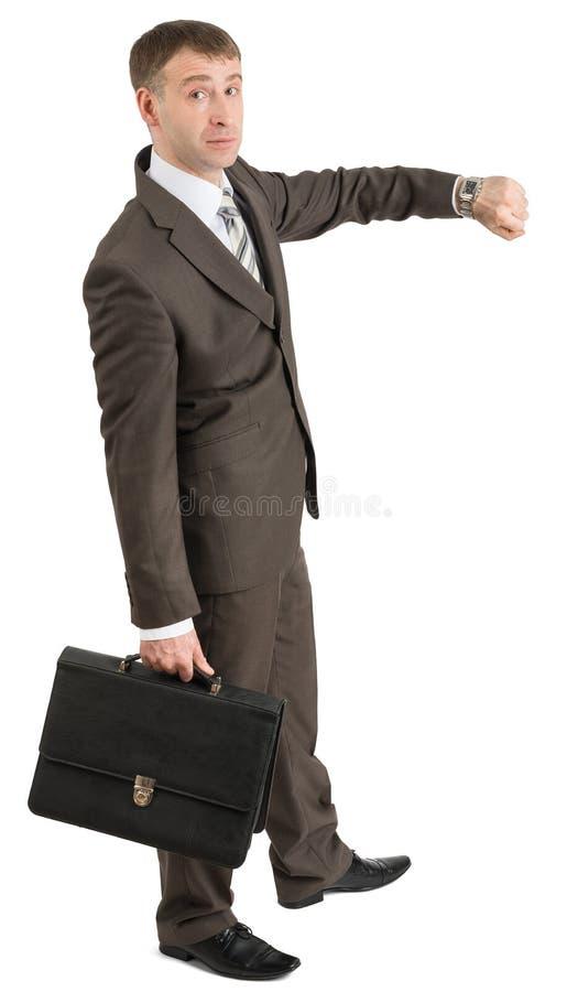 Download Biznesmen Patrzeje Jego Rękę Obraz Stock - Obraz złożonej z biznesmen, finanse: 65225503