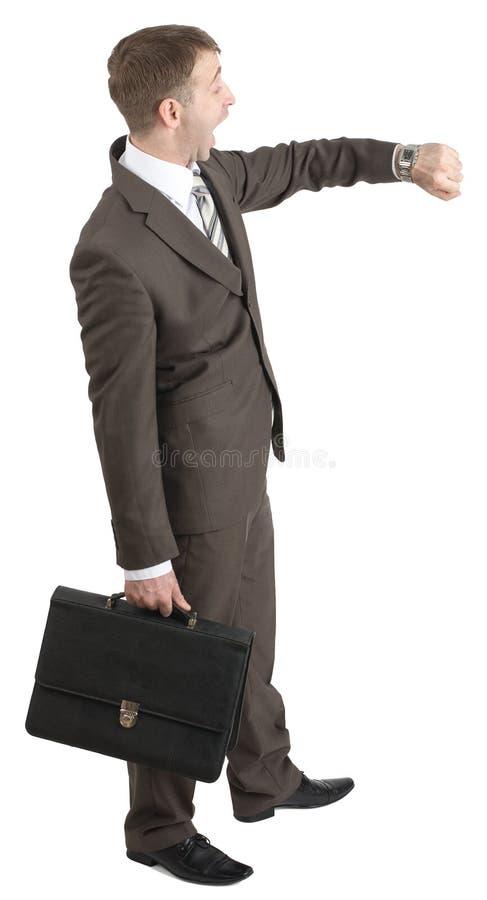 Download Biznesmen Patrzeje Jego Rękę Obraz Stock - Obraz złożonej z facet, dojeżdżający: 65225511