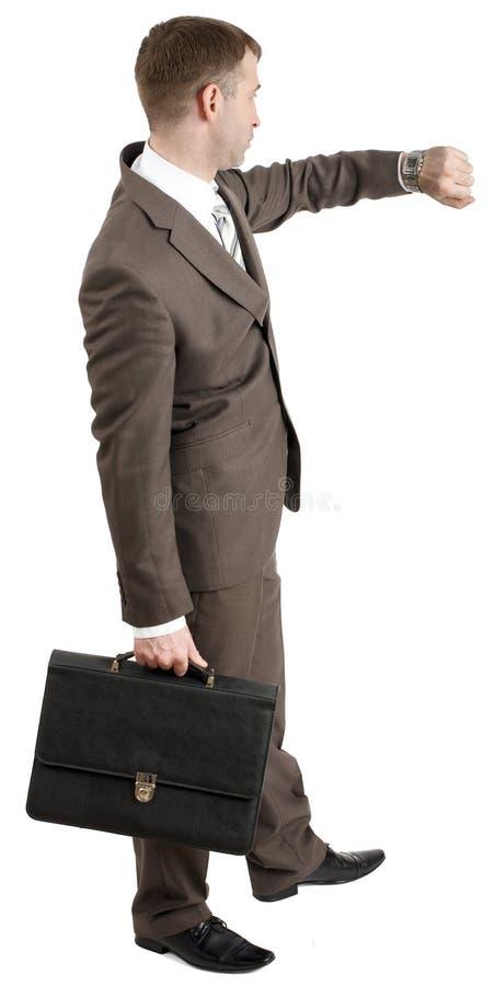 Download Biznesmen Patrzeje Jego Rękę Zdjęcie Stock - Obraz złożonej z biznesmen, kostium: 65225706
