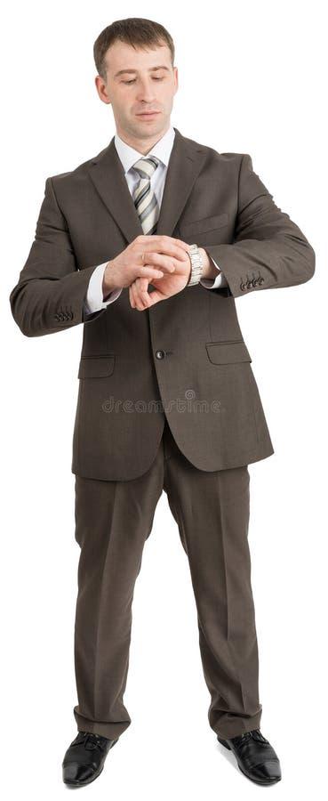 Download Biznesmen Patrzeje Jego Rękę Obraz Stock - Obraz złożonej z facet, zaufanie: 65225737