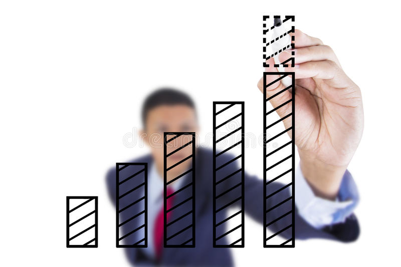 Biznesmen patrzeje up i writing wykresu baru przyrost zdjęcia stock