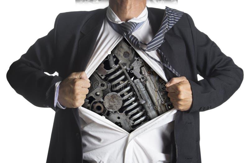 Biznesmen pokazuje bohatera kostium pod maszyneria metalem zdjęcie royalty free