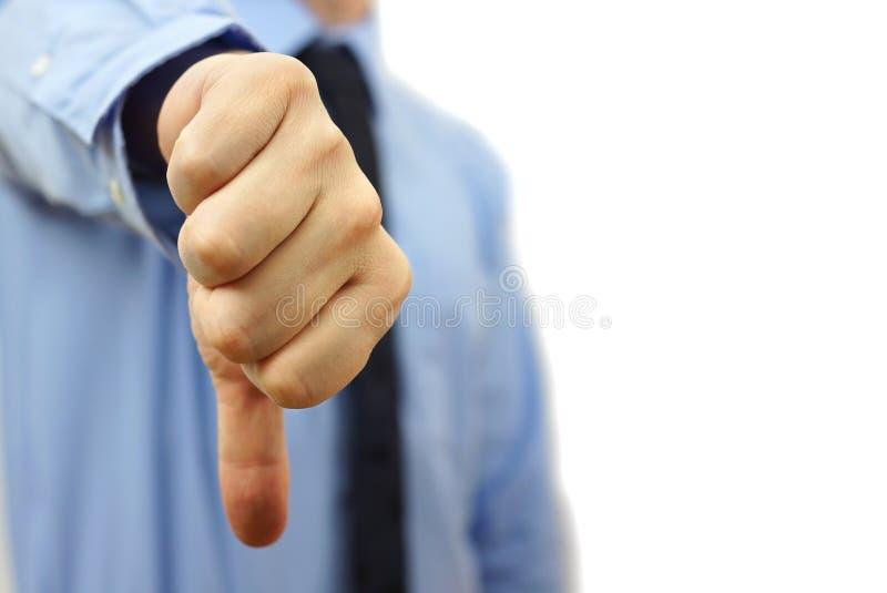 Biznesmen pokazuje kciuki zestrzela obrazy stock